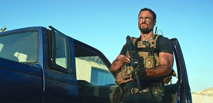 13 Hours' Dominic Fumusa stands beside vehicle with gun ready