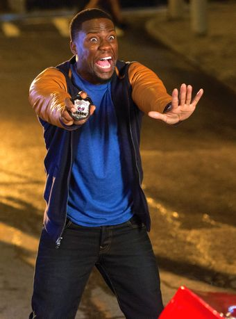 Ride Along 2's Kevin Hart holds out police badge as he tries to stop a car from hitting him
