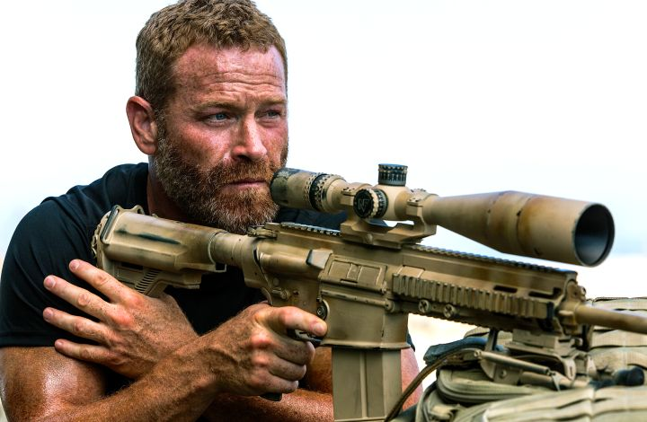 13 Hours' Max Martin aims his rifle at enemy