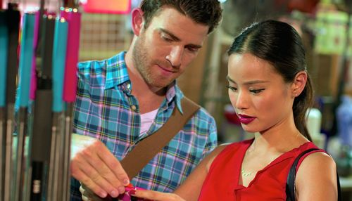 Already Tomorrow in Hong Kong's Jamie Chung & Bryan Greenberg examine object in Hong Kong street shop