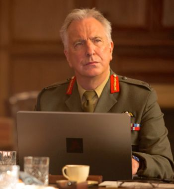 Eye in the Sky's Alan Rickman glances up from his laptop