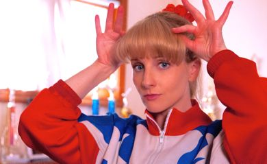 The Bronze's Melissa Rauch adjusts her blonde hair