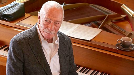 Remember's Christopher Plummer looks away from piano he finished playing