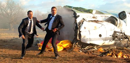 London Has Fallen's Gerard Butler rushes Aaron Eckhart from crashed helicopter in park outisde London