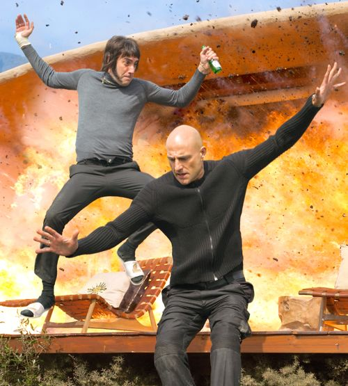 Brothers Grimsby's Sacha Baron Cohen and Mark Strong leap to safety as building explodes