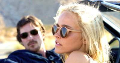 Knight of Cup's Isabel Lucas looks out of convertible as Christian Bale stares at her