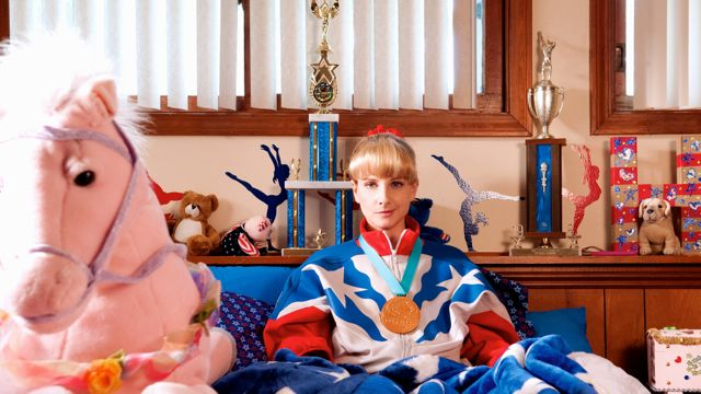 The Bronze's Melissa Rauch sits on bed amid her Olympic trophies
