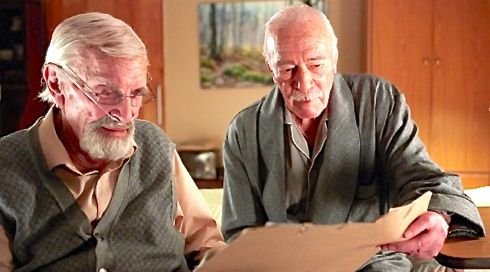 Remember's Martin Laudau and Christopher Plummer look at documents while seated