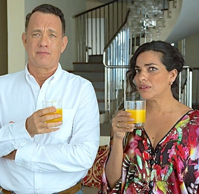 Hologram for King's Tom Hanks and Sarita Choudhury holds drinks in her seaside townhouse