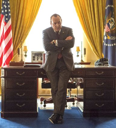 Elvis & Nixon's Kevin Spacey stands in front of Oval Office desk