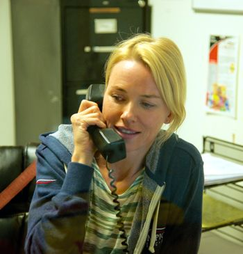 Demolition's Naomi Watts talks on telephone in her office