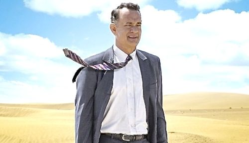 Hologram for King's Tom Hanks stands in Saudi desert with tie flying in breeze