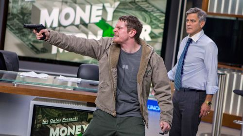 Money Monster's Jack O'Connell points gun while TV host George Clooney looks on helplessly