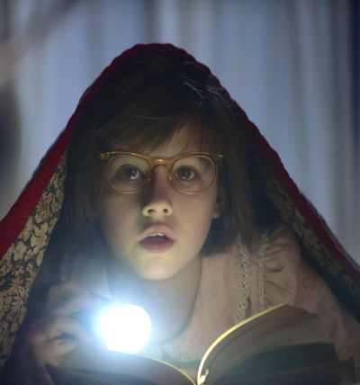 BFG's Ruby Barnhill reads book by flashlight under bed covers