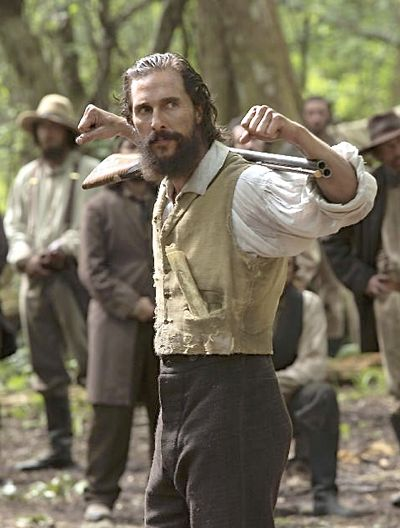 Free State of Jomes' Matthew McConaughey slings rifle over shoulder as his renegade soldiers look on in swamp