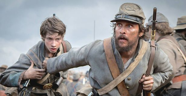 Free State of Jones' Matthew McConaughey leads frightened young boy through Civil War battlefield