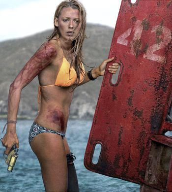 The Shallows' Blake Lively holds flare gun while clinging to buoy in her bikini