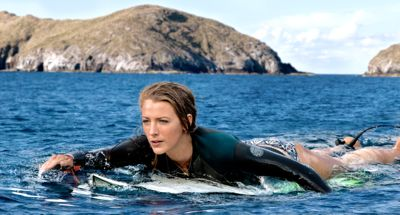 The Shallows' Blake Lively paddles surf board toward shore