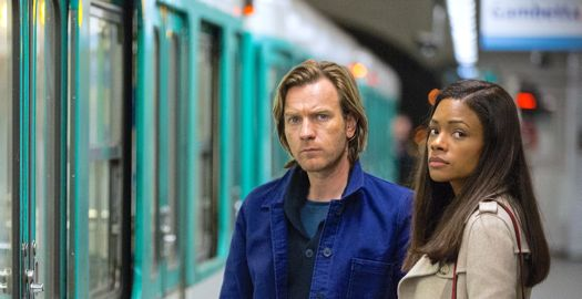 Our Kind of Traitor's Ewan McGregor, Naomie Harris stand next to train on station platform
