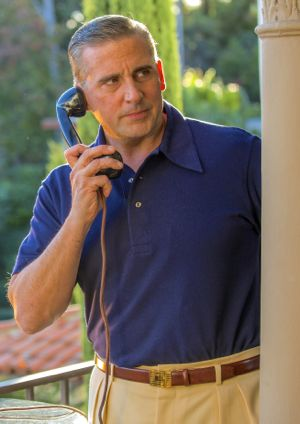 Cafe Society's Steve Carell telephones in mansion's garden