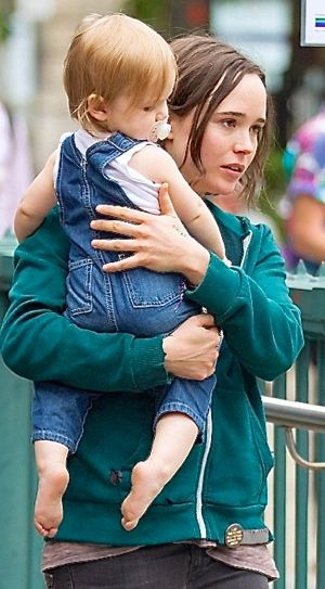 Tallulah's Ellen Page holds baby as she walks down New York street