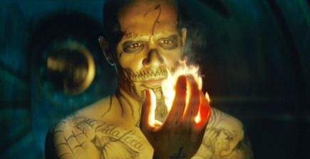 Suicide Squad's Jay Hernandez as El Diablo gazes at fire in his own hand