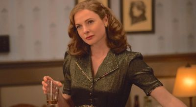 Florence Foster Jenkins' Rebecca Ferguson holds cocktail and looks to her right
