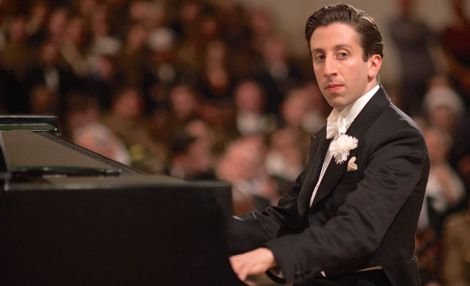 Florence Foster Jenkins' Simon Helberg plays grand piano while wearing tux