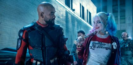 Suicide Squad's Will Smith and Margot Robbie stroll down nighttime street weapons at hand