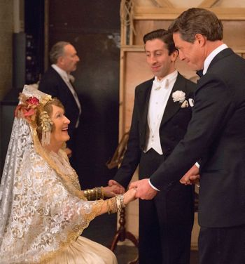 Florence Foster Jenkins' Meryl Streep sits and enthusiastically chats with Simon Helberg and Hugh Grant