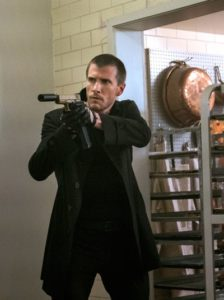 Jack Reacher's Patrick Heusinger aims gun in restaurant kitchen