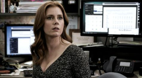 Arrival's Amy Adams looks to her left in computer room