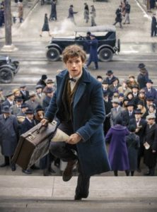 Fantastic Beasts' Eddie Redmayne rushes up outside stairs as crowd looks on from below