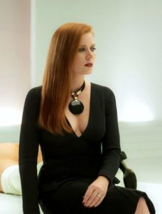 Nocturnal Animals' Amy Adams dressed and turned out immaculately sits in art gallery