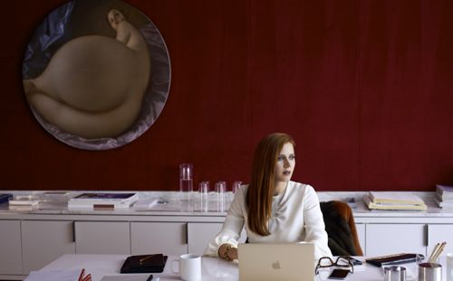Nocturnal Animals' Amy Adams stares to her left from her art gallery office