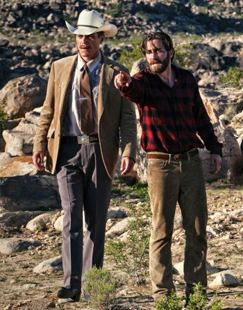 Nocturnal Animals' Jake Gyllenhaal, standing in Texas desert, points to crime scene or sheriff Michael Shannon