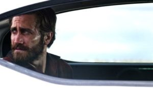 Nocturnal Animals' Jake Gyllenhaal stares out of car's backseat window