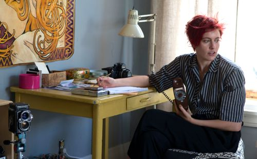 20th Century Women's Greta Gerwig looks over shoulder from her writing table