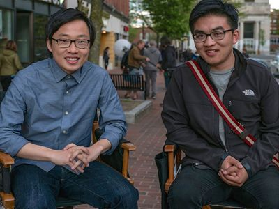 Patriots Day's Jimmy O. Yang seated next to Dun Meng, real-life person he plays