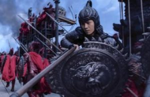 Great Wall's Lu Han aims spear as he holds a shield on the Great Wall